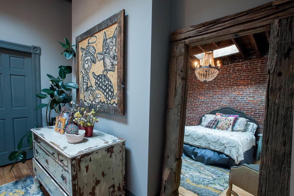 the-reclaimed-wood-framed-door-to-an-eclectic-bedroom.jpg